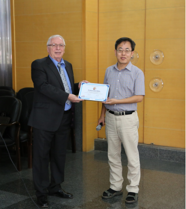 Professor Xiqiao Feng, BICTAM Secretary-General presented Professor Daniel Weihs with the Certificate of 2017 BICTAM Master Lecture Series Program